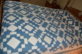 Blue And White Handstitched Quilt