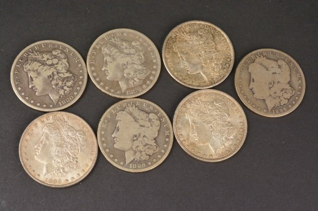 (7) Morgan Silver Dollars