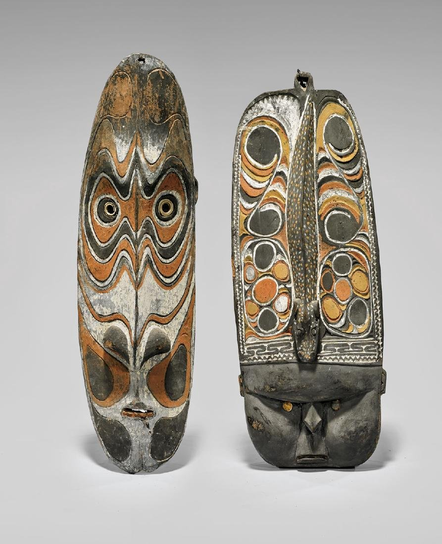 TWO OCEANIC CARVED & PAINTED WOOD MASKS