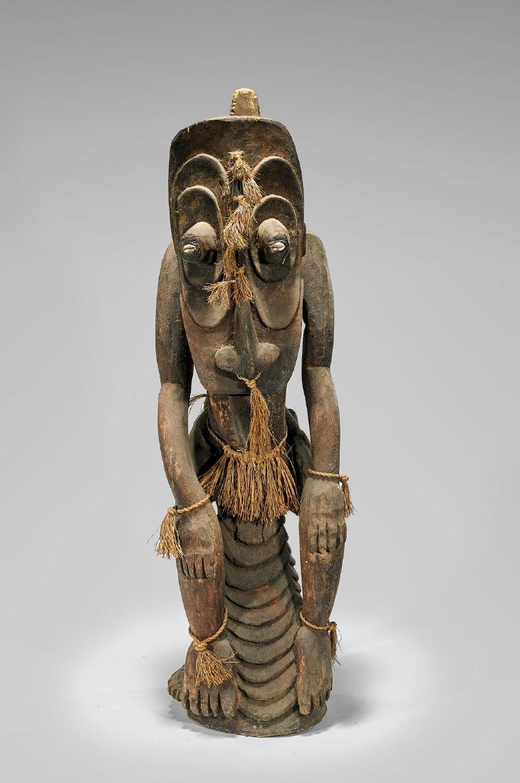 LARGE OCEANIC WOOD FIGURE WITH CROCODILE