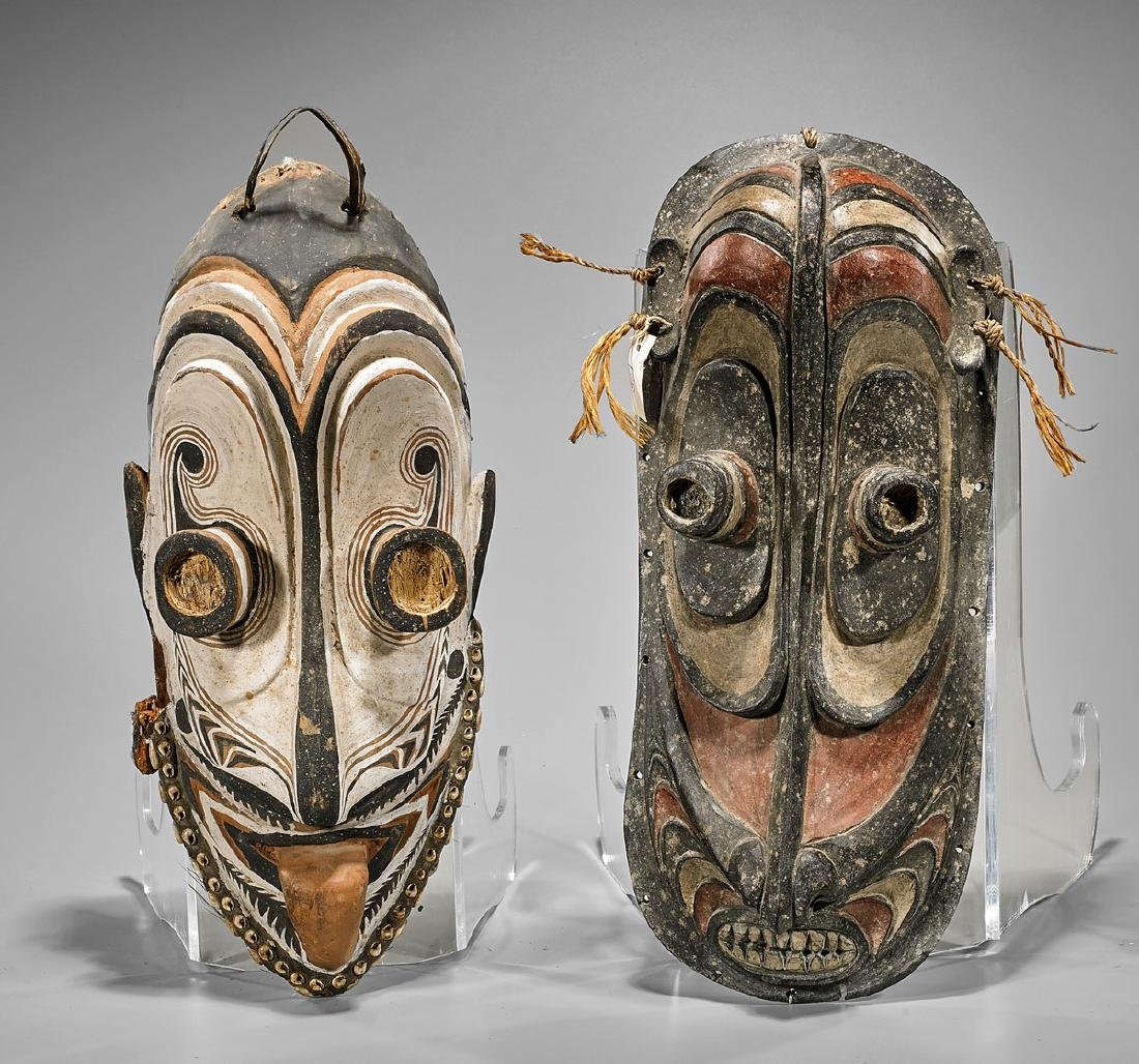 Two Oceanic Carved & Polychrome Wood Masks