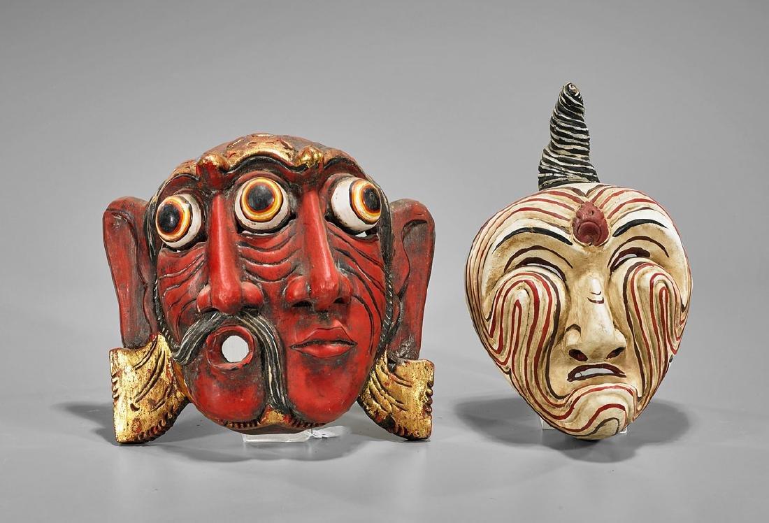 Four Indonesian Polychrome Wood Masks