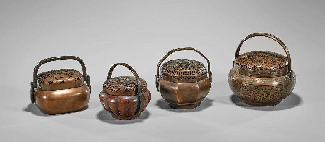 Group of Four Antique Chinese Hand Warmers