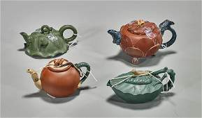 Group of Four Yixing Pottery Teapots