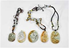 Five Carved Jadeite or Hardstone Pendants