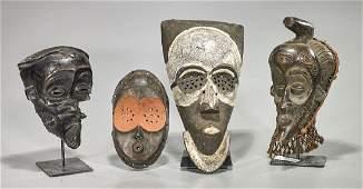 Group of Four Lulua Masks