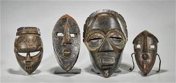 Group of Four DRC Carved Wood Masks