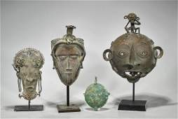 Group of Four African Bronze Masks