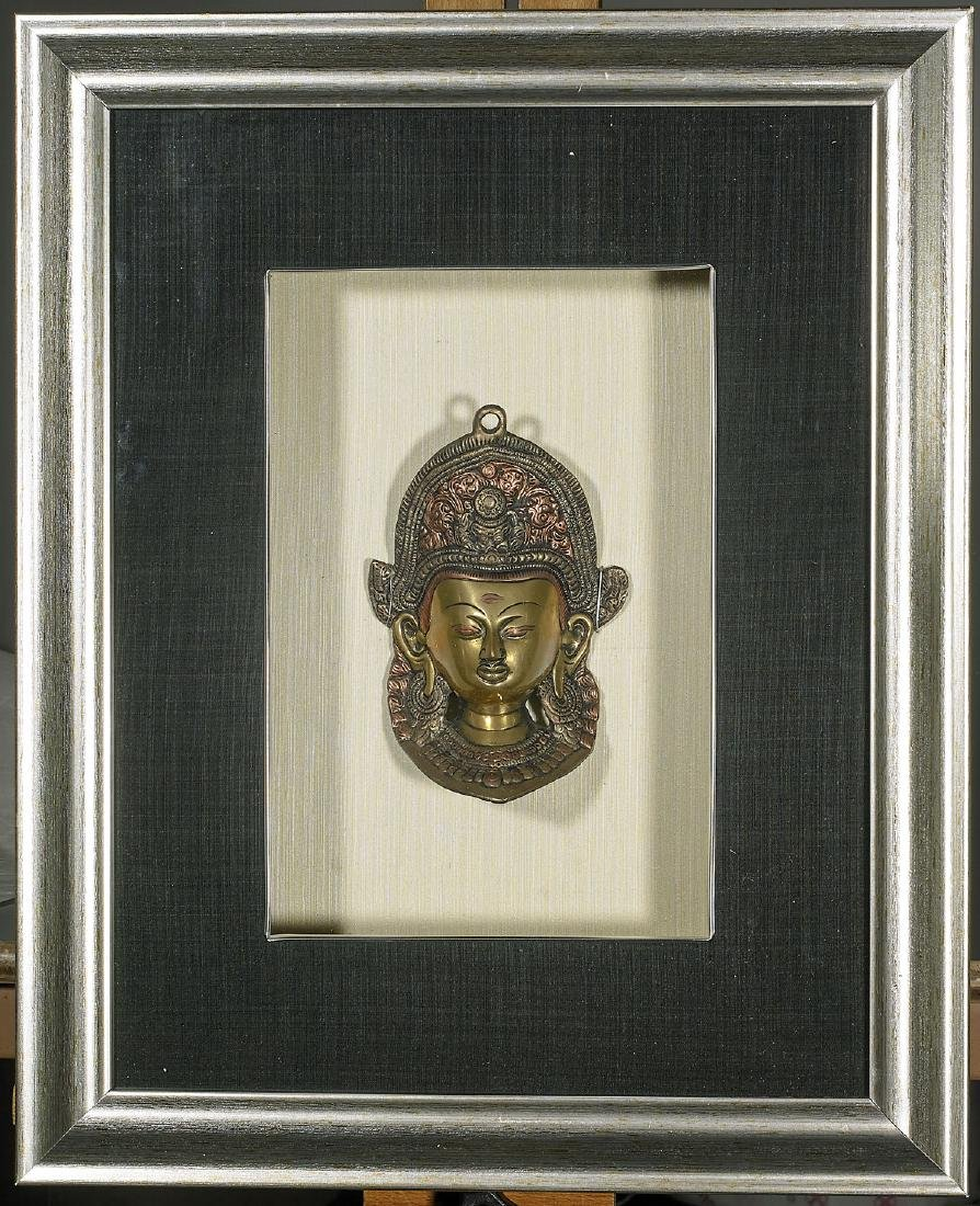 Two Sino-Tibetan Bronze Heads of Buddha