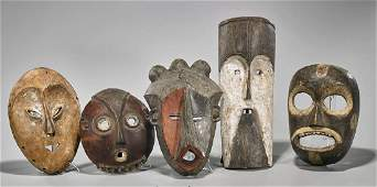 Group of Five Various African Carved Wood Masks