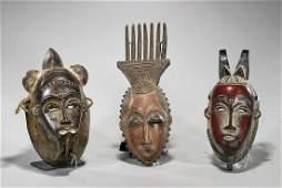 Group of Seven Baule Carved Wood Masks