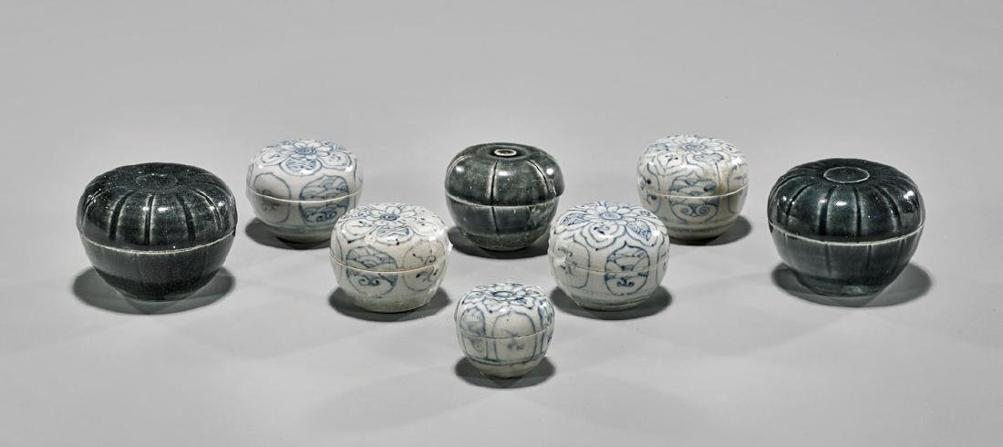 GROUP OF EIGHT ANTIQUE VIETNAMESE COVERED BOXES