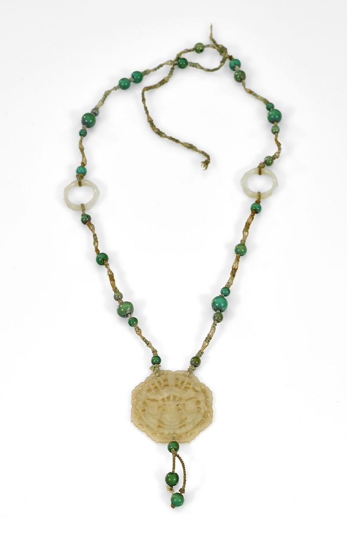 ANTIQUE CARVED JADE PLAQUE ON NECKLACE