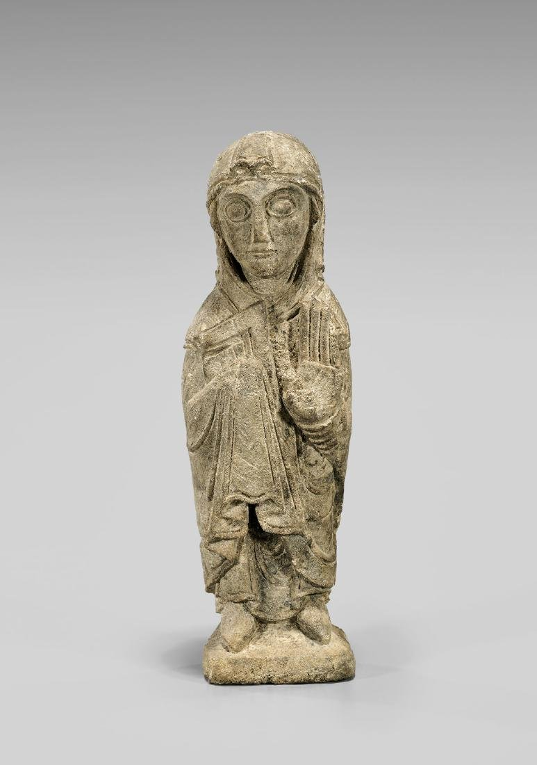 ROMANESQUE LIMESTONE FIGURE OF THE VIRGIN