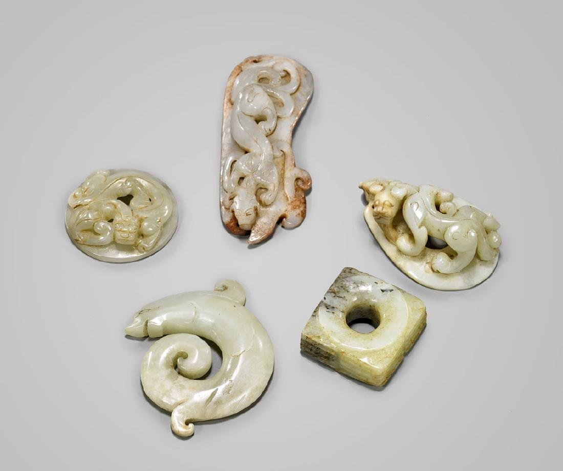 SIX ARCHAISTIC CHINESE JADE CARVINGS