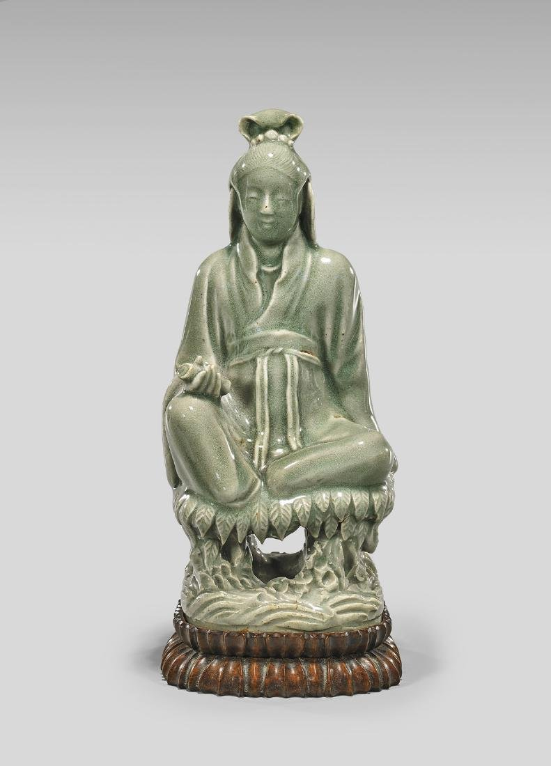 MING DYNASTY CELADON FIGURE OF GUANYIN