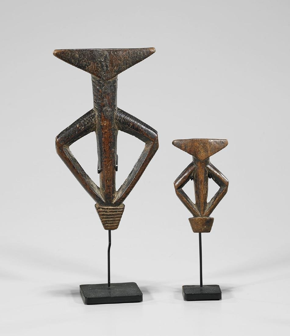 TWO MOSSI CARVED WOOD FLUTES