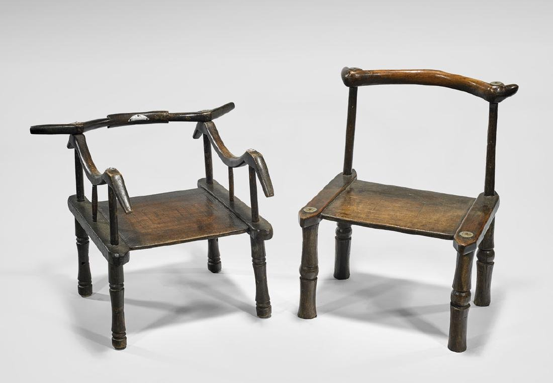 TWO IVORY COAST CARVED WOOD CHAIRS