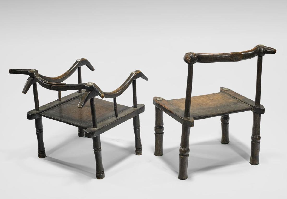 TWO IVORY COAST CARVED WOOD CHAIRS - 2