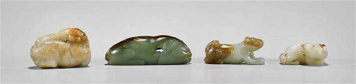 FOUR CARVED JADE ANIMALS