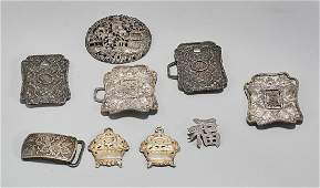 Group of Nine Chinese Silver Buckles & Ornaments