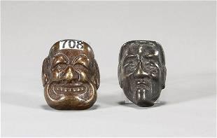 Two Antique Bronze Mask Netsuke