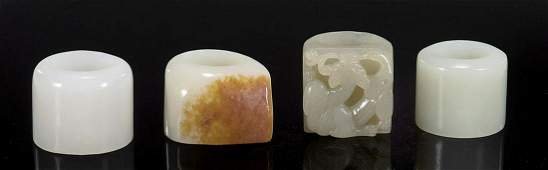 Group of Four Chinese Carved Jade Archer's Rings