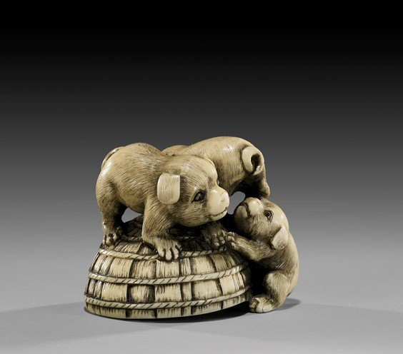 8: CARVED IVORY NETSUKE: Three Puppies