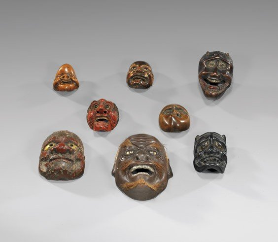 20: EIGHT MINIATURE CARVED ANTIQUE MASKS