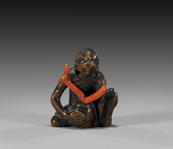 22: ANTIQUE WOOD NETSUKE: Ascetic & Coral Branch