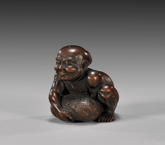 23: OKIMONO-SIZED WOOD NETSUKE: Rock Lifter