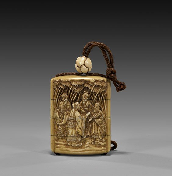 ANTIQUE THREE-CASE CARVED IVORY INRO