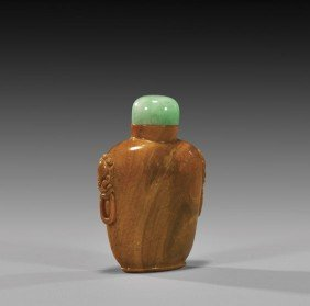 CARVED AMBER SNUFF BOTTLE