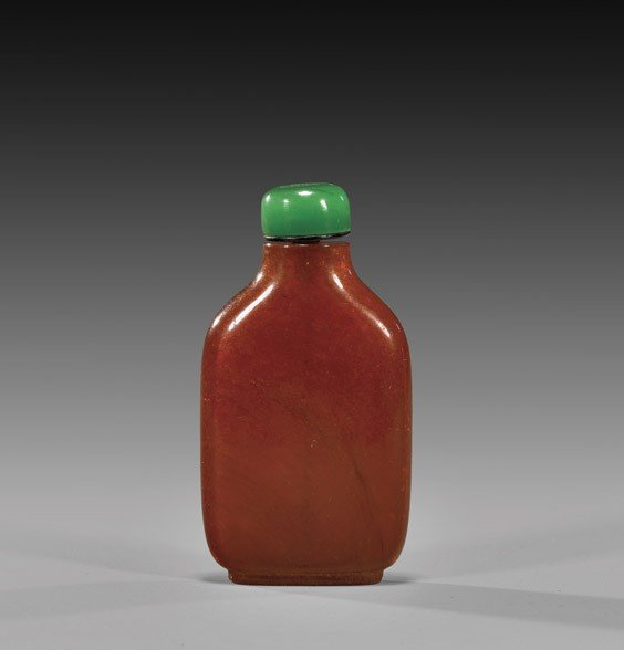 ANTIQUE AMBER FOOTED SNUFF BOTTLE