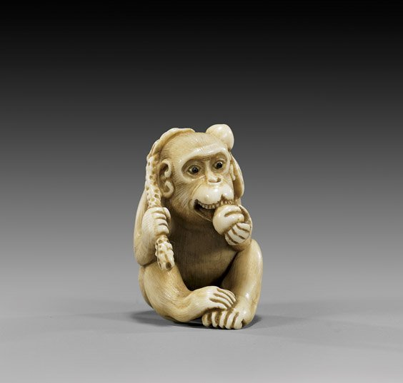 9: CARVED IVORY NETSUKE: Monkey & Peach