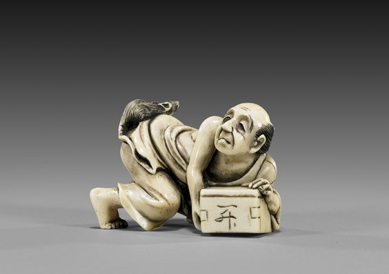 11: CARVED IVORY NETSUKE: Rat Catcher