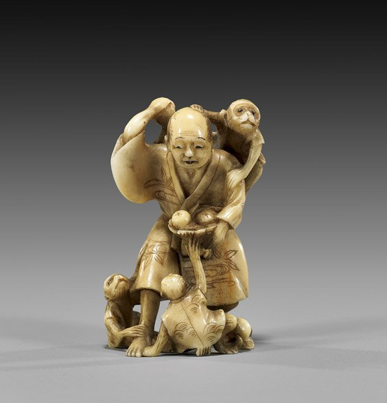 12: ANTIQUE IVORY FIGURAL OKIMONO