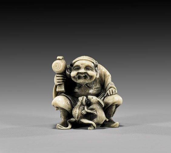 15: CARVED IVORY NETSUKE: Seated Daikoku