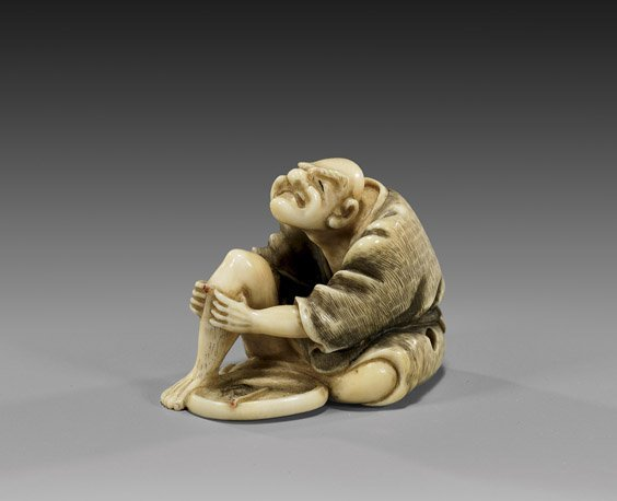17: CARVED IVORY NETSUKE: Seated Man