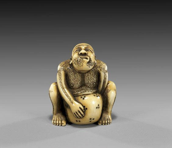 18: ANTIQUE IVORY NETSUKE: Stone Lifter