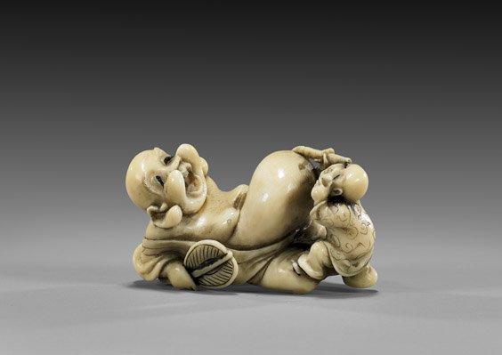 22: CARVED IVORY NETSUKE: Boy & Hotei