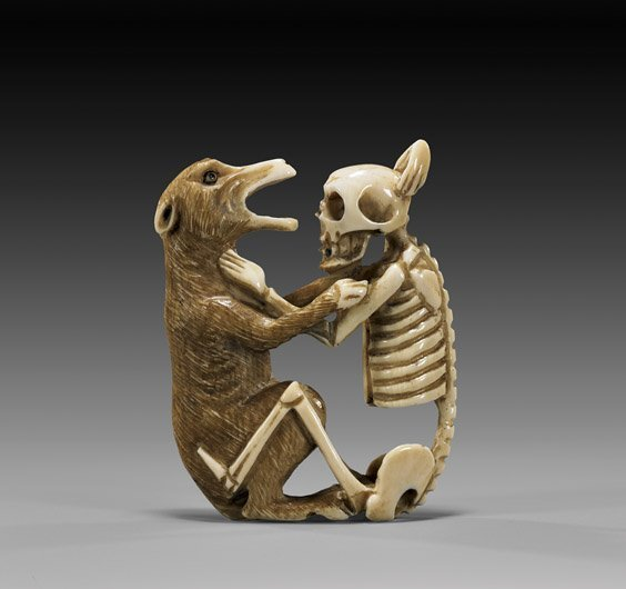 10: UNUSUAL IVORY NETSUKE: Wolf & Skeleton