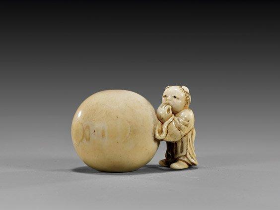 18: ANTIQUE IVORY NETSUKE: Boy with Ball