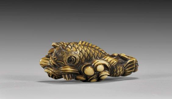 19: ANTIQUE IVORY NETSUKE: Fish & Waves