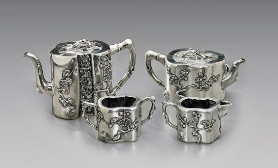 FOUR ANTIQUE REPOUSSÉ EXPORT SILVER TEA SET