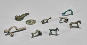 Nine Ancient Fibulae & Button
