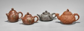 Four Chinese Yixing Pottery Teapots