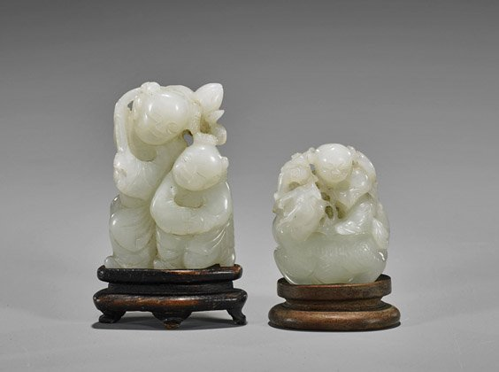Two Antique Carved Celadon Jade Toggles