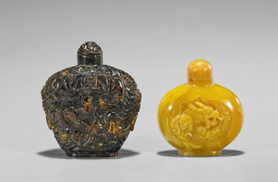 Two Carved Amber-Like Snuff Bottles