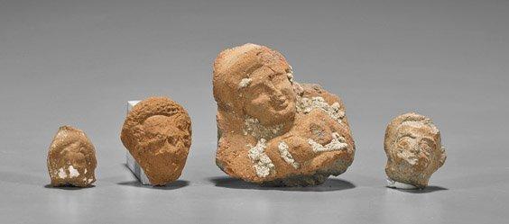 Four Roman/Egyptian Terracotta Heads